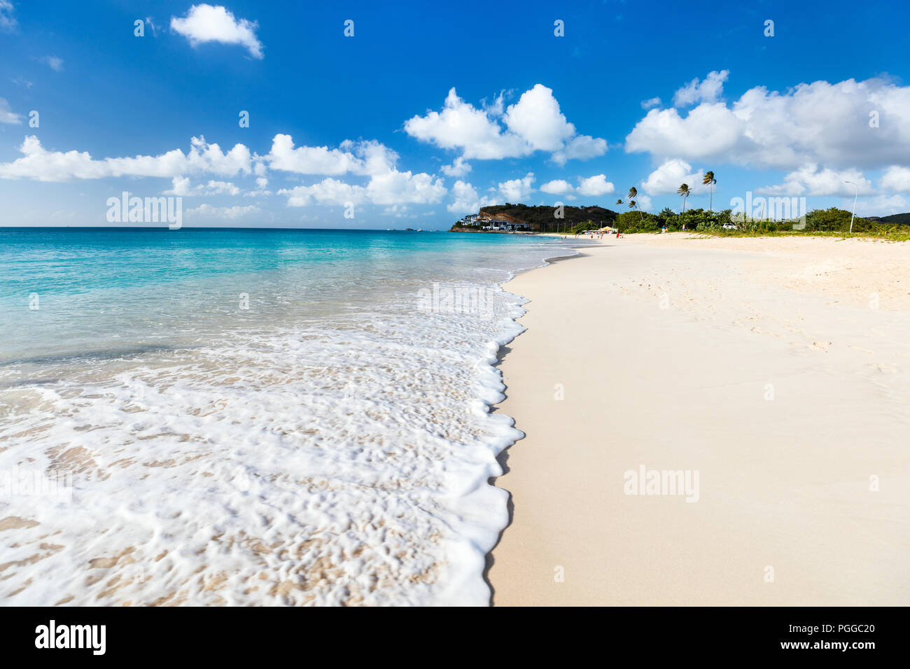 Idyllic tropical Darkwood beach at Antigua island in Caribbean with white sand, turquoise ocean water and blue sky Stock Photo