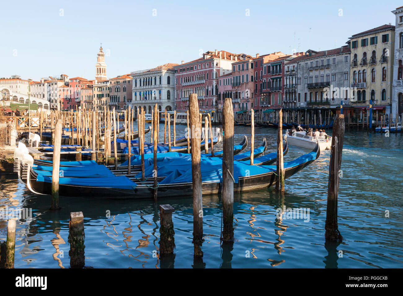 Moored gondolas on the Grand Canal at sunset, San Polo, Venice, Veneto, Italy on a beautiful winter evening - Stock Image