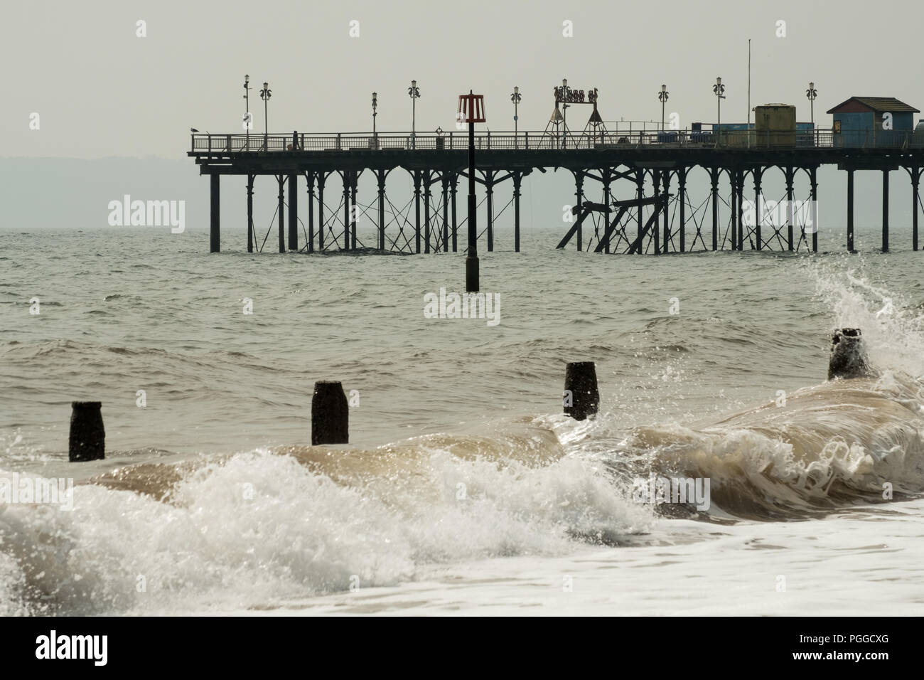 Teignmouth Grand Pier during winter gales on the beach, Devon, England, UK. Stock Photo