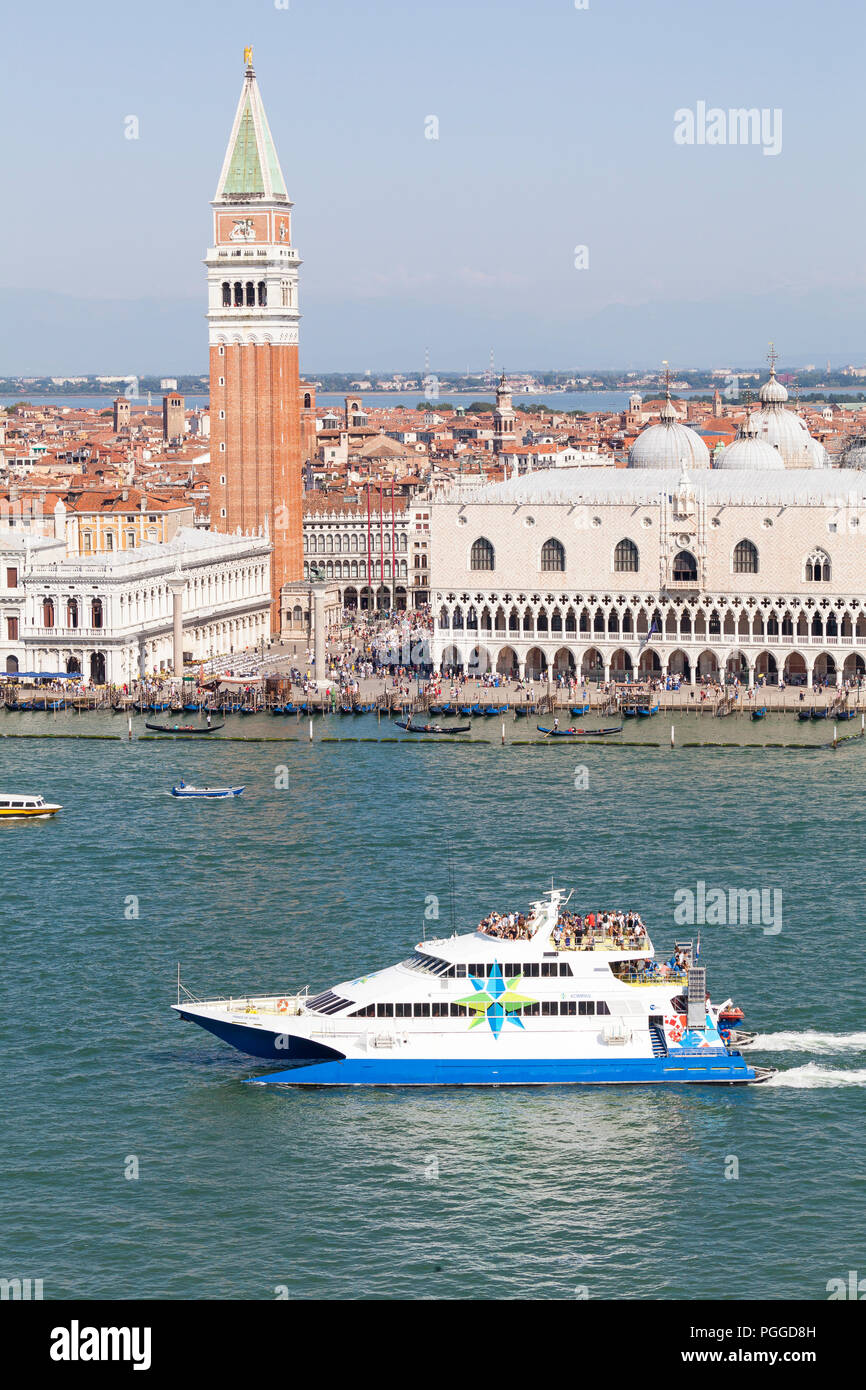 Prince of Venice high speed catamaran ferry from Istria arriving at Venice, Veneto, Italy passing the Doges Palace and Campanile,  St Marks basin, aer - Stock Image
