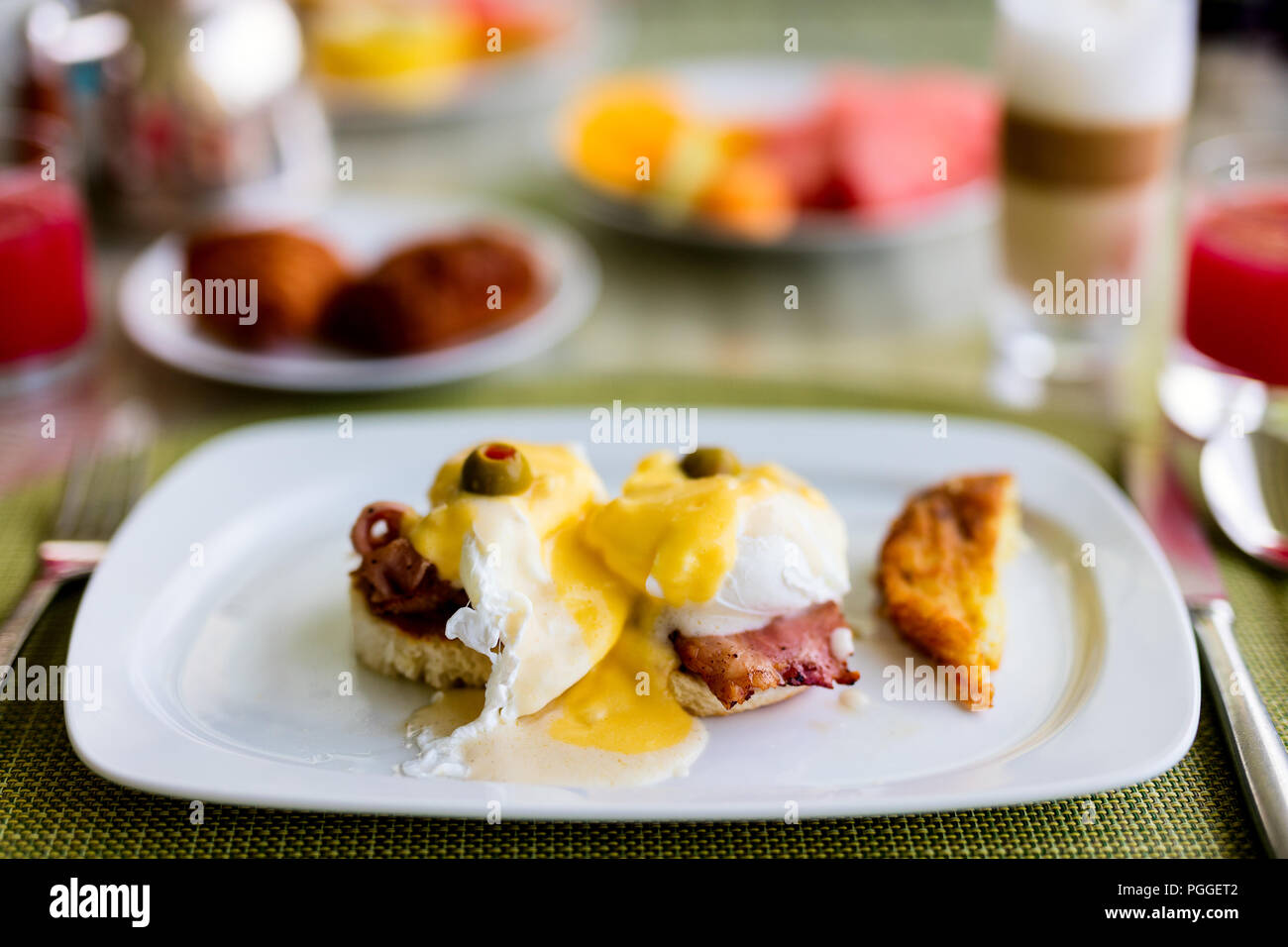 Delicious breakfast with eggs Benedict and coffee - Stock Image