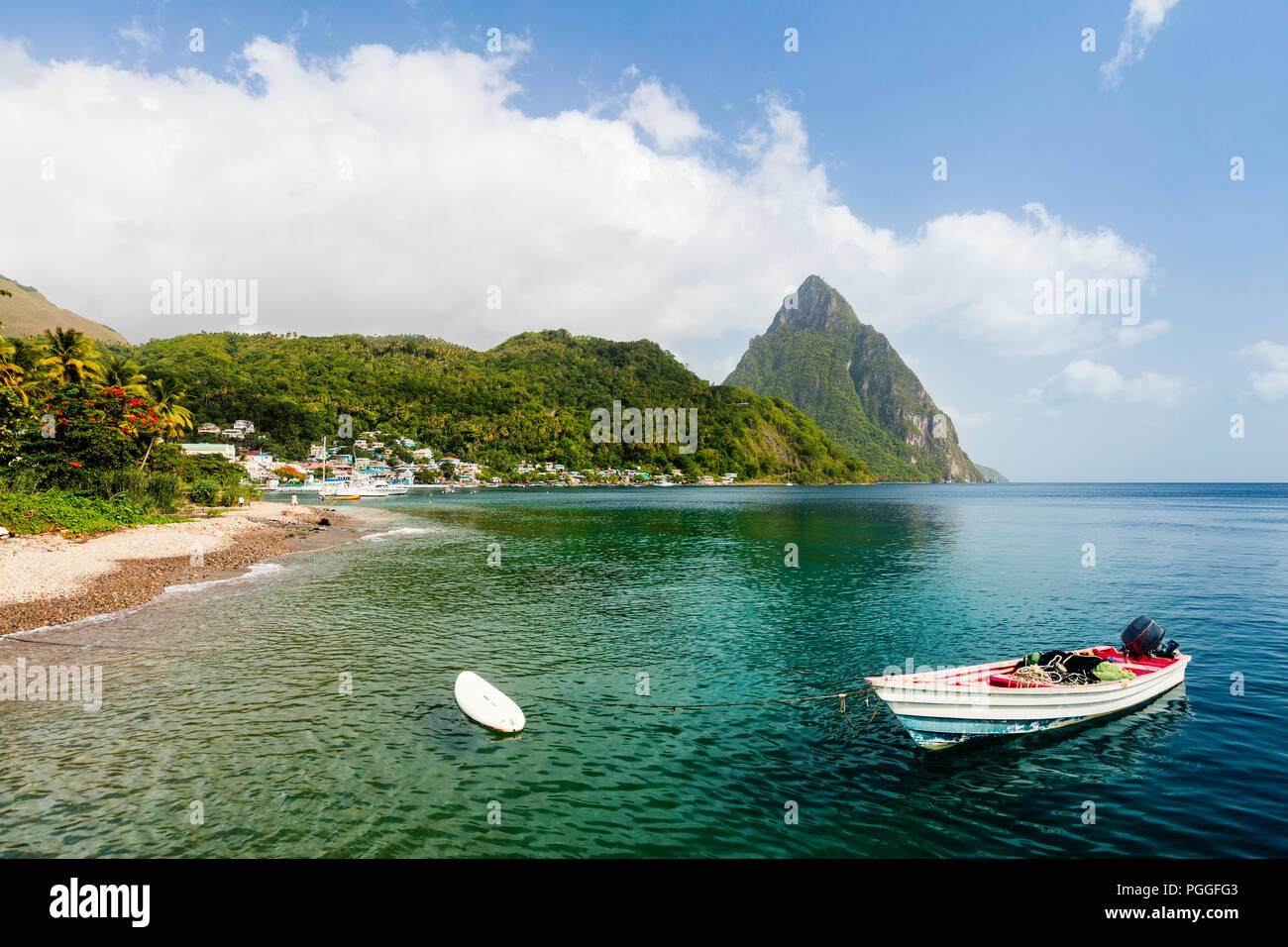 Idyllic white sand tropical beach with view to Piton mountains in Saint Lucia Caribbean Stock Photo