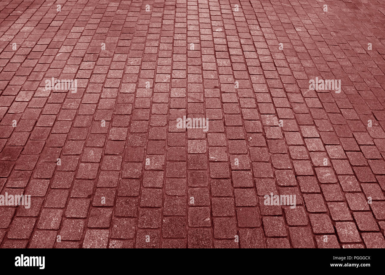 Red Brown Colored Concrete Block Paved Pathway for Texture Background, Banner or Pattern - Stock Image