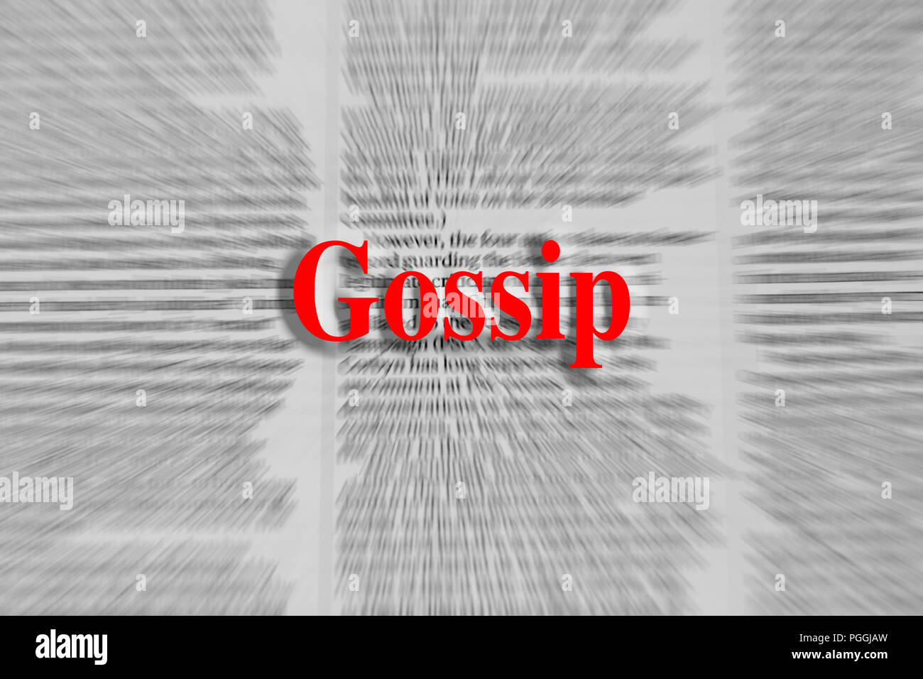 Gossip written in red with a newspaper article blurred in the background Stock Photo