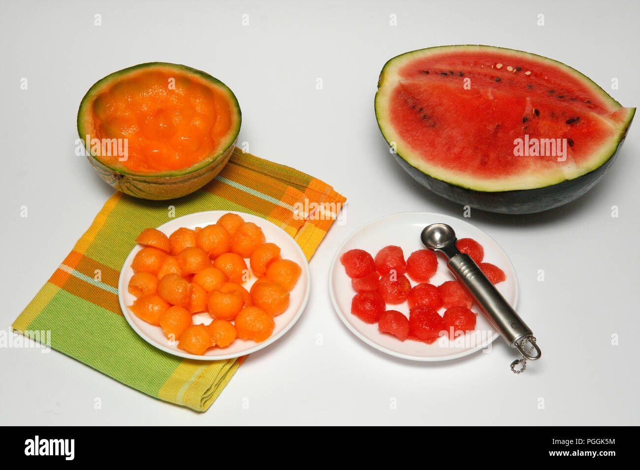 Stuffed melon with fruits and ice cream. Step by step. Prepared dish: BNH06T - Stock Image