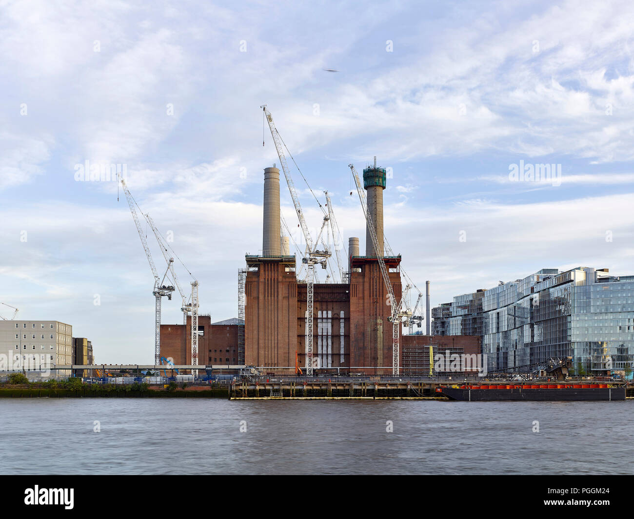 View across Thames. Battersea Power Station, under construction, London, United Kingdom. Architect: Sir Giles Gilbert Scott, 1953. - Stock Image