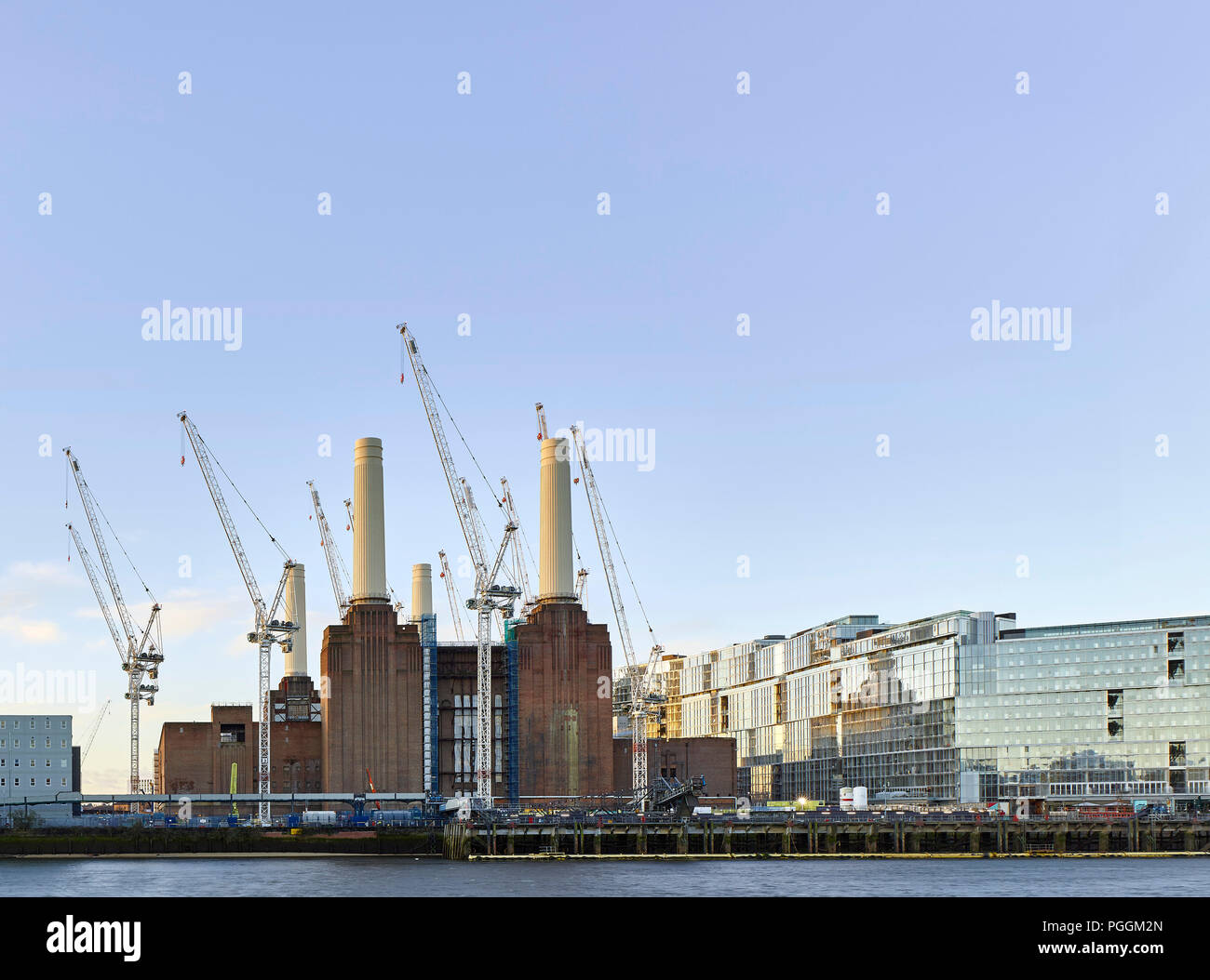 View across river Thames. Battersea Power Station, under construction, London, United Kingdom. Architect: Sir Giles Gilbert Scott, 1953. - Stock Image