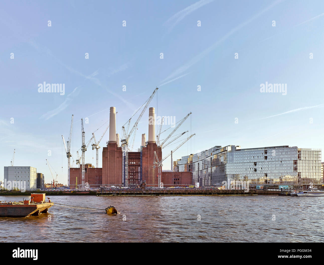 View from north with sunlight. Battersea Power Station, under construction, London, United Kingdom. Architect: Sir Giles Gilbert Scott, 1953. - Stock Image