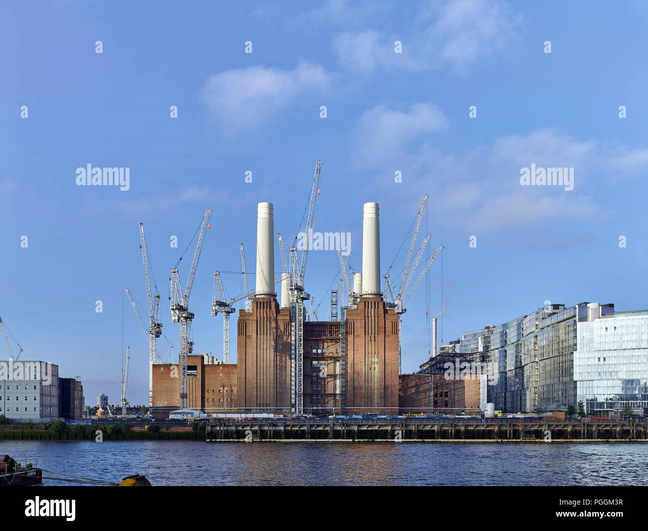 Front view across river. Battersea Power Station, under construction, London, United Kingdom. Architect: Sir Giles Gilbert Scott, 1953. - Stock Image