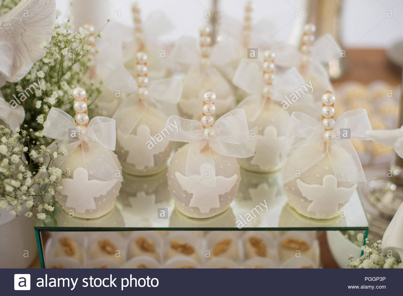 Table decorated with apples - Baptism - Stock Image