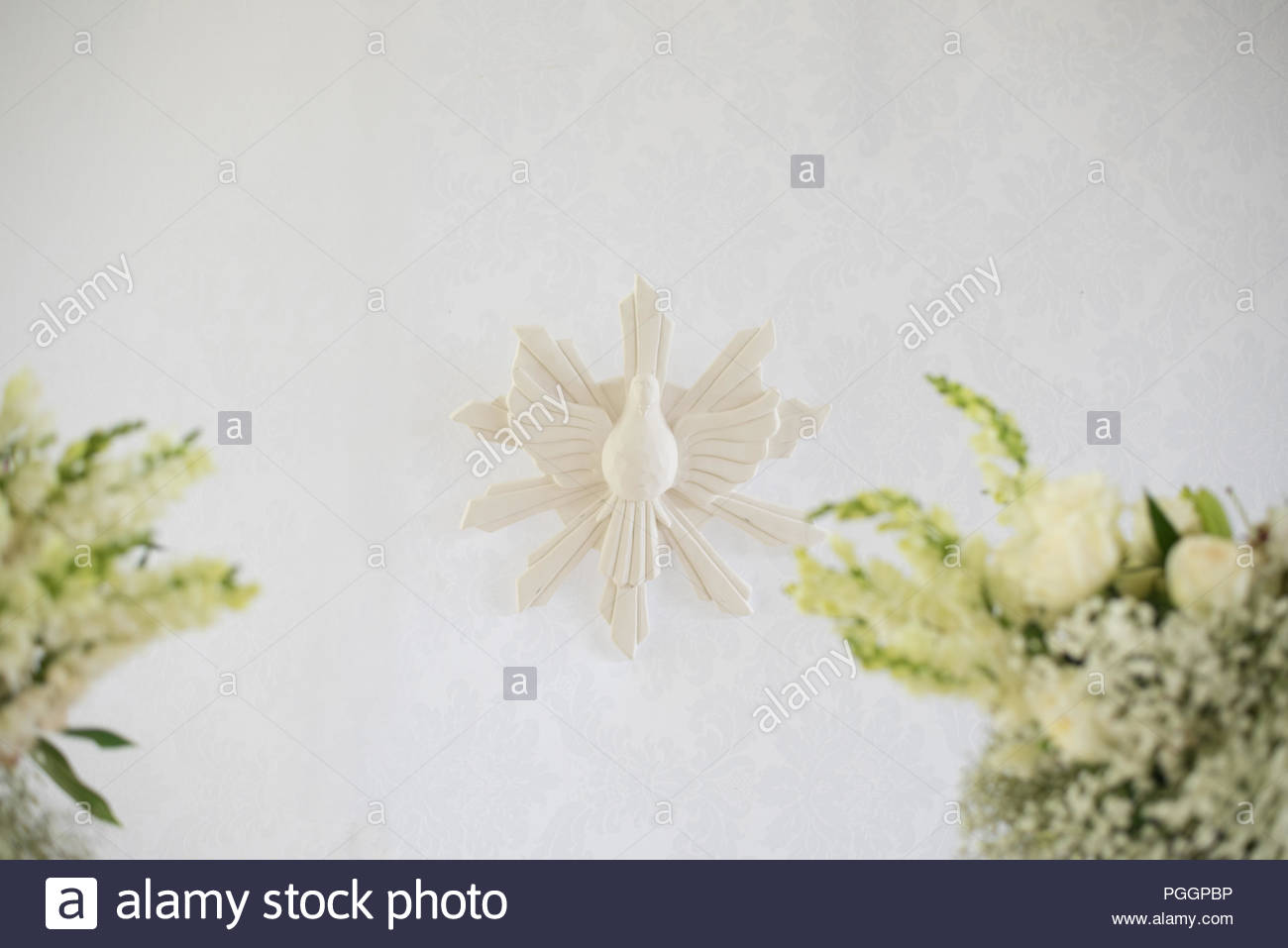 Detail of decoration, flowers and angelic - Baptism - Stock Image