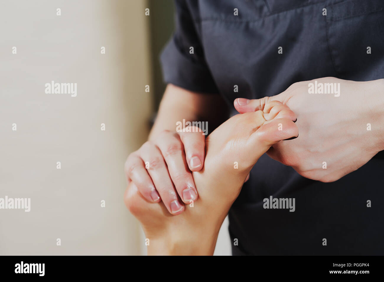 Close-up Of A Physiotherapist Giving Exercise On Man's Foot. Stock Photo