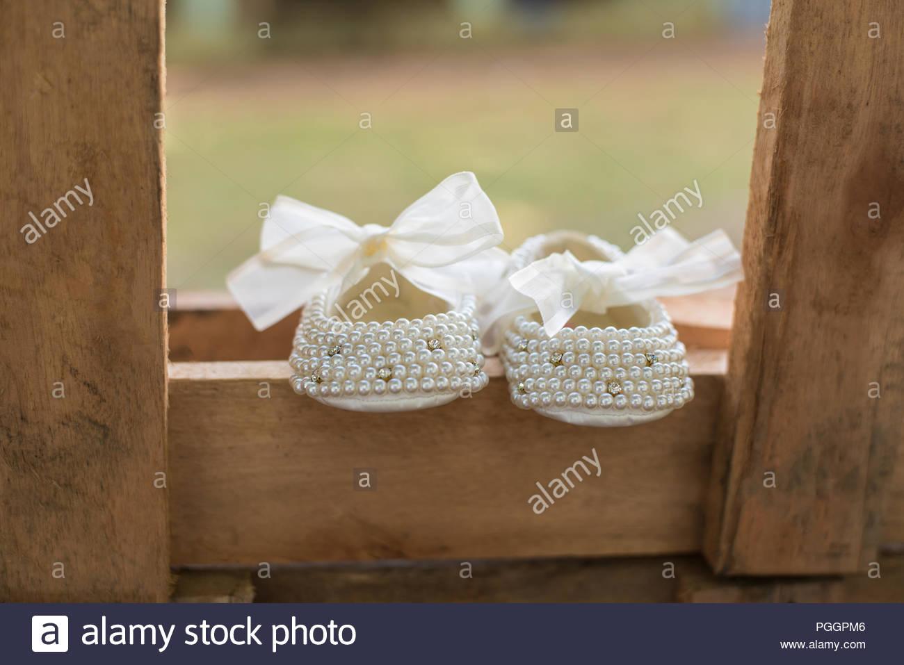 Baby girl shoes - Baptism - Stock Image