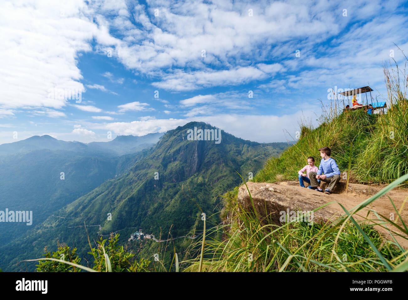 af77d162f Kids enjoying breathtaking views over mountains and tea plantations from Little  Adams peak in Ella Sri Lanka