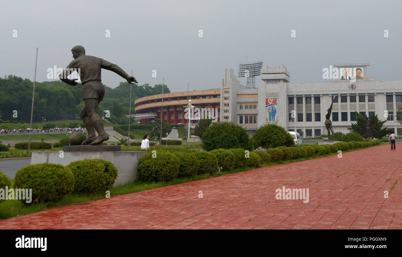 Statue of a football player and other sports outside the Kim II Sung sports stadium in Pyongyang, North Korea - Stock Image