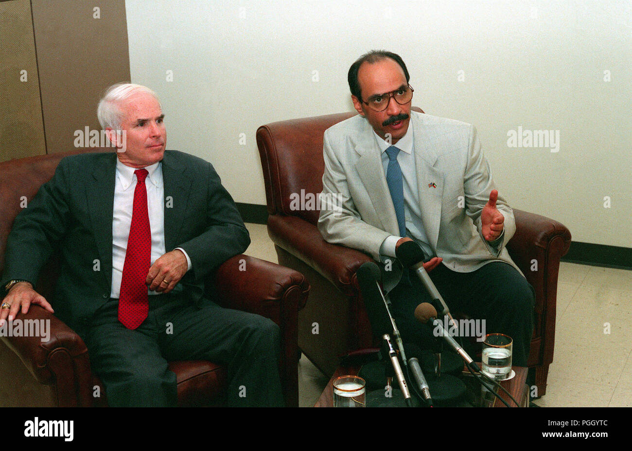 Sheikh Saud Nasir Al Sabah, third from right, Kuwait's ambassador to the U.S., answers a question during a press conference as Sen. John McCain of Arizona listens.   Al Sabah has come to Davis-Monthan to thank the base's personnel for their role in Operation Desert Shield and Operation Desert Storm, which liberated Kuwait from its Iraqi invaders.  Flanking Al Sabah and McCain are Col. Joe Greene, left, and Col. Glyn Burleson, right. - Stock Image
