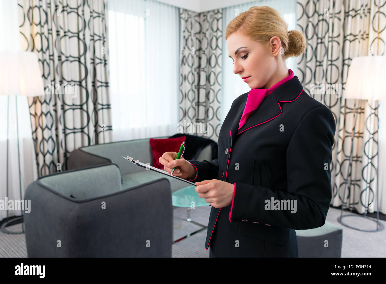 Housekeeper checking hotel suite Stock Photo