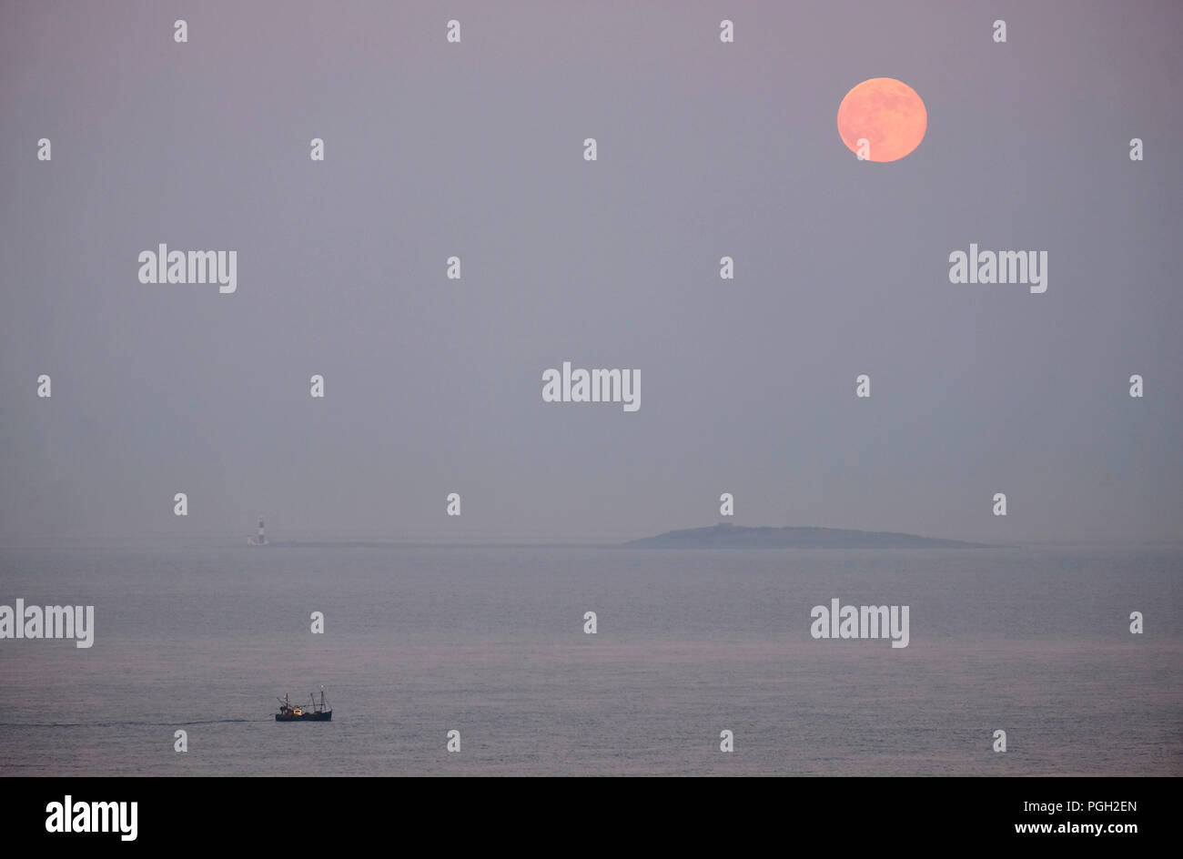 Full Moon rising over Mew Island, Copeland Islands, Belfast Lough. - Stock Image