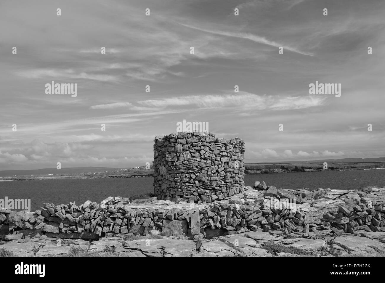 Remains of a round tower on the Eastern shore of Inishmore, Aran Islands. - Stock Image