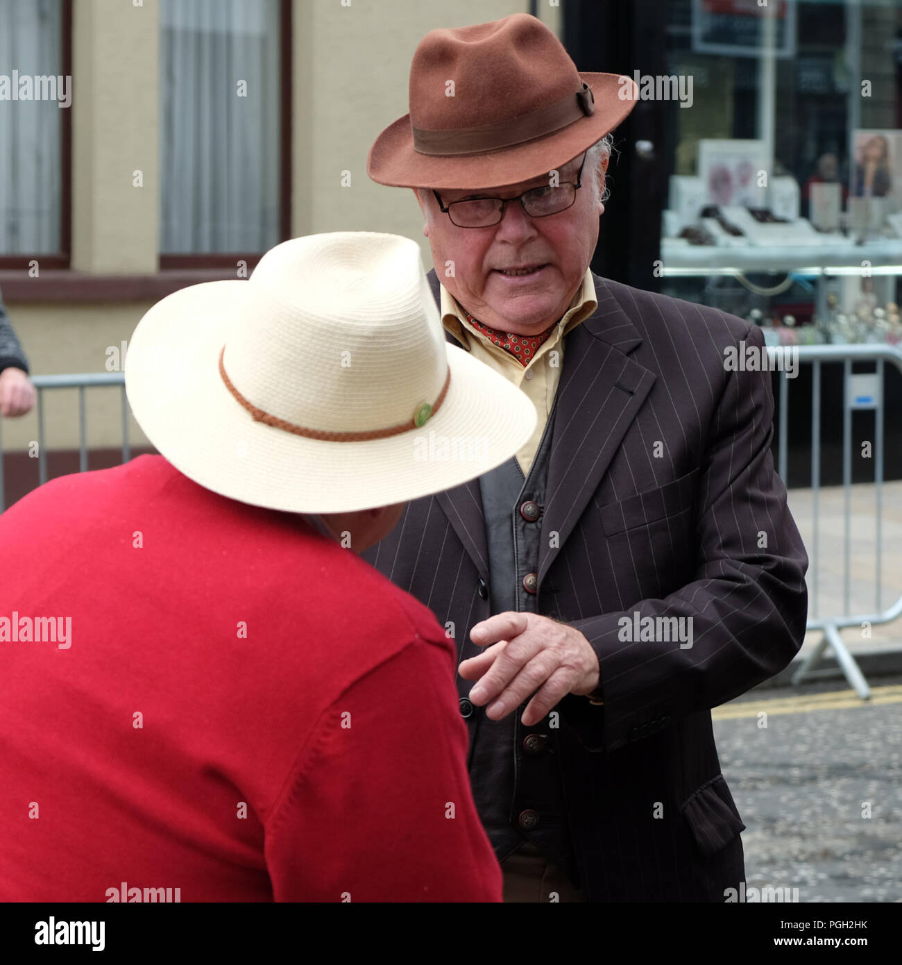 Two men at the May Fair, Ballyclare, County Antrim, Northern Ireland. - Stock Image