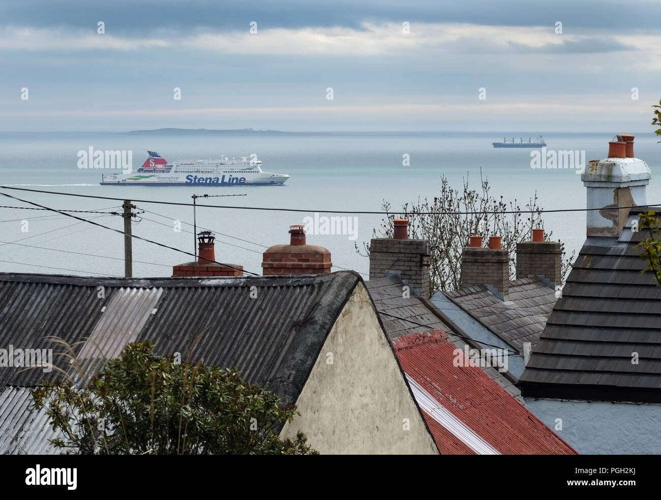 Shipping on Belfast Lough & the rooftops of Blackhead village, County Antrim, Northern Ireland. - Stock Image