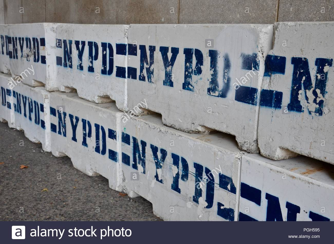 Barrier wall in New York City, USA, travel, traffic, streets, cars, vacation, urban, security, safety, wall, architecture, background, day, symbol - Stock Image