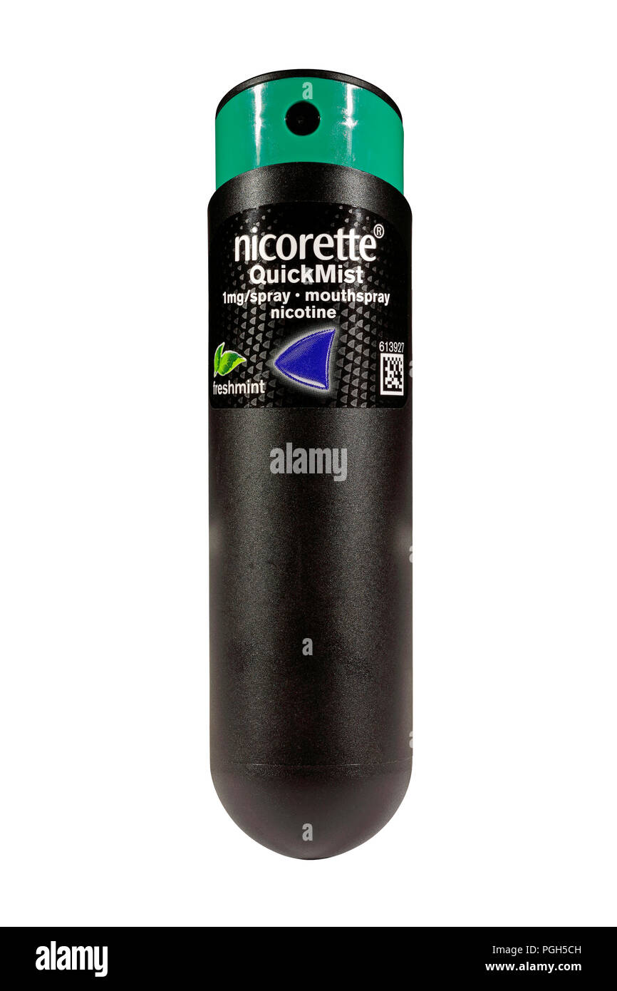 A bottle of freshmint nicorette QuickMist 1mg/spray nicotine mouthspray isolated on a white background.  Nicotine replacement therapy. Quiting smoking - Stock Image