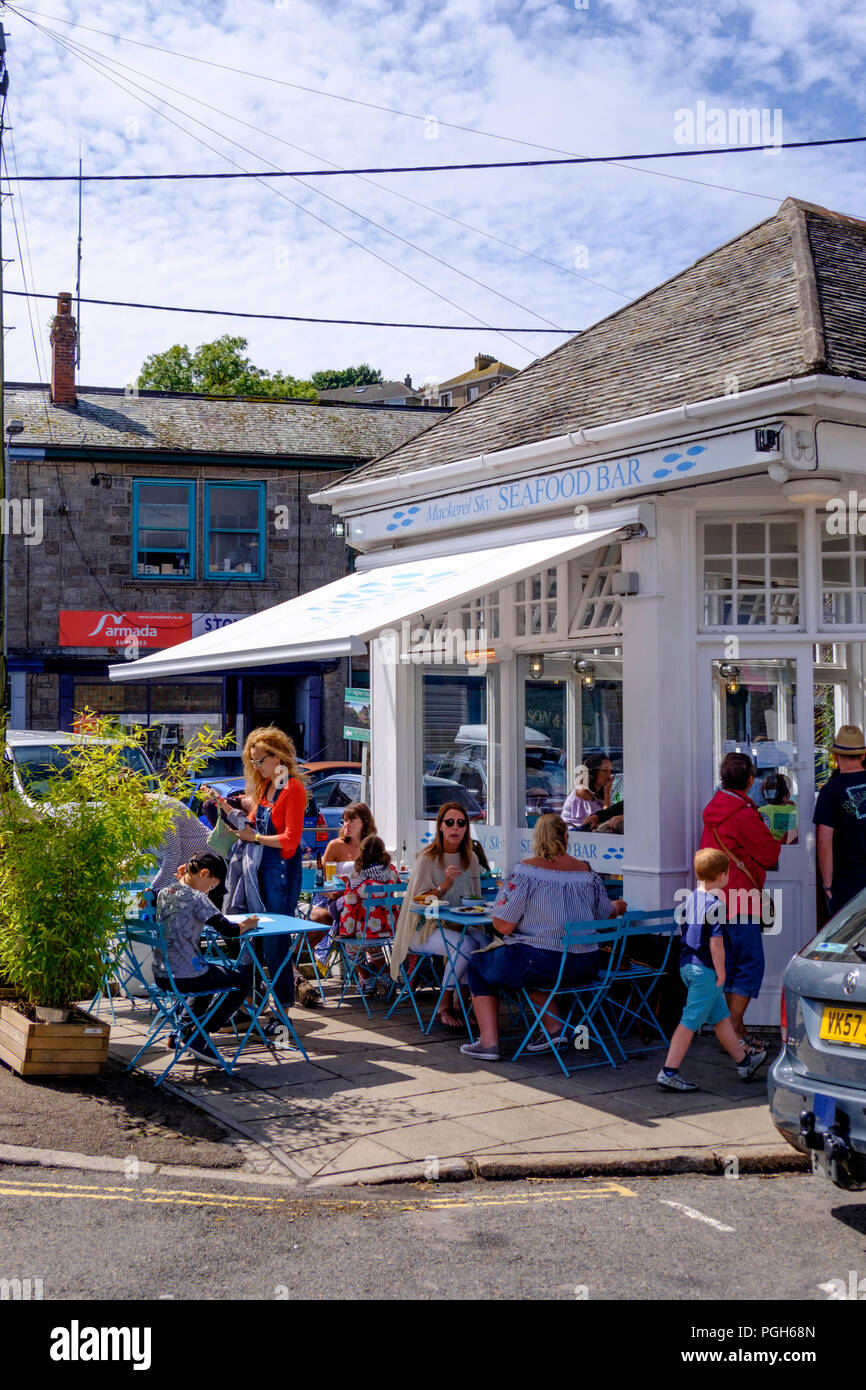 Around Newlyn an active fishing village on the Cornish coast. Cornwall england UK Mackerel Sky Seafood Bar - Stock Image