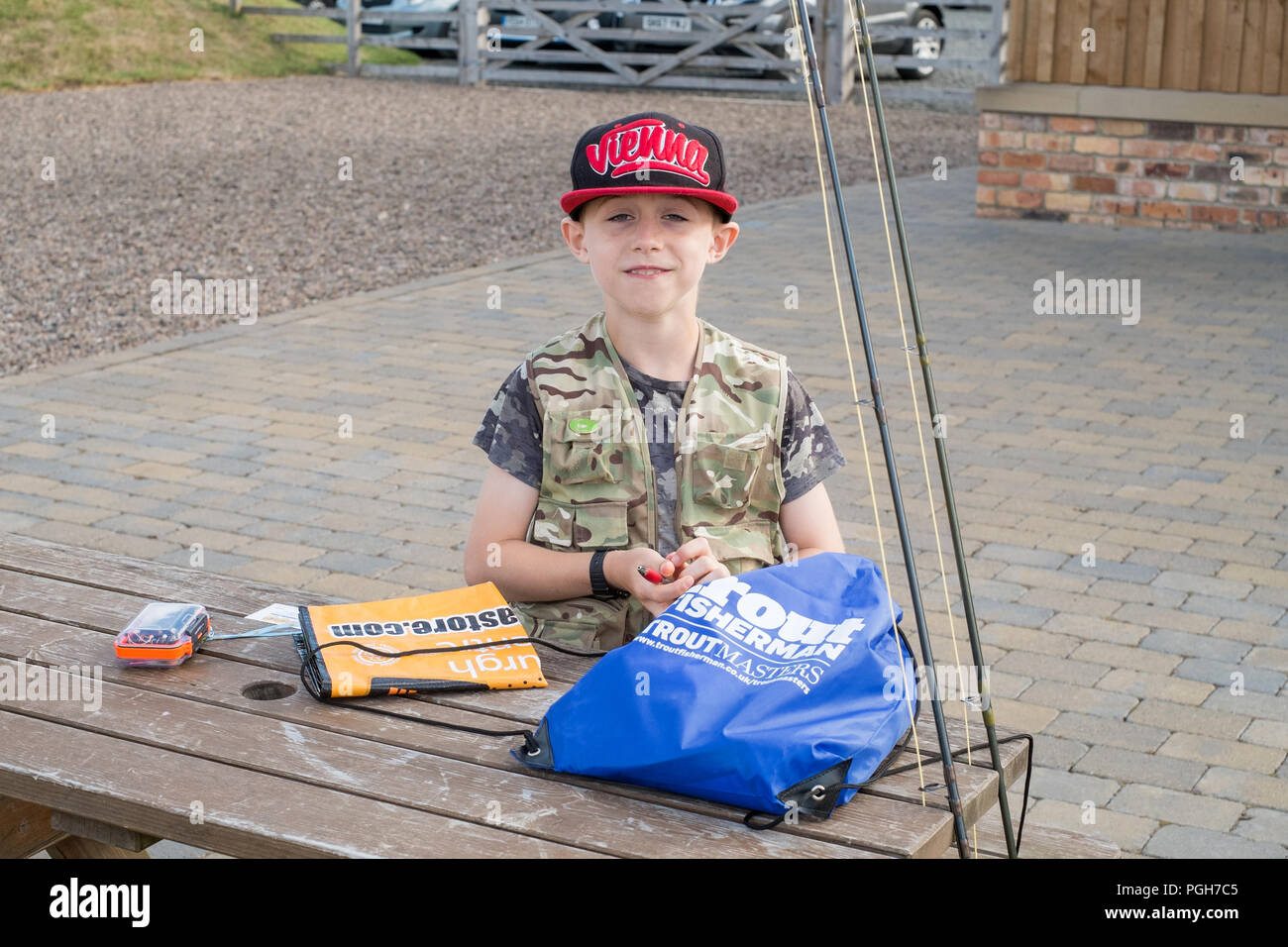 Nine year old boy at the Junior Troutmasters 2018 semi final, Thunton Long Crag Trout fishery, Thrunton, Northumberland, England, United Kingdom. - Stock Image