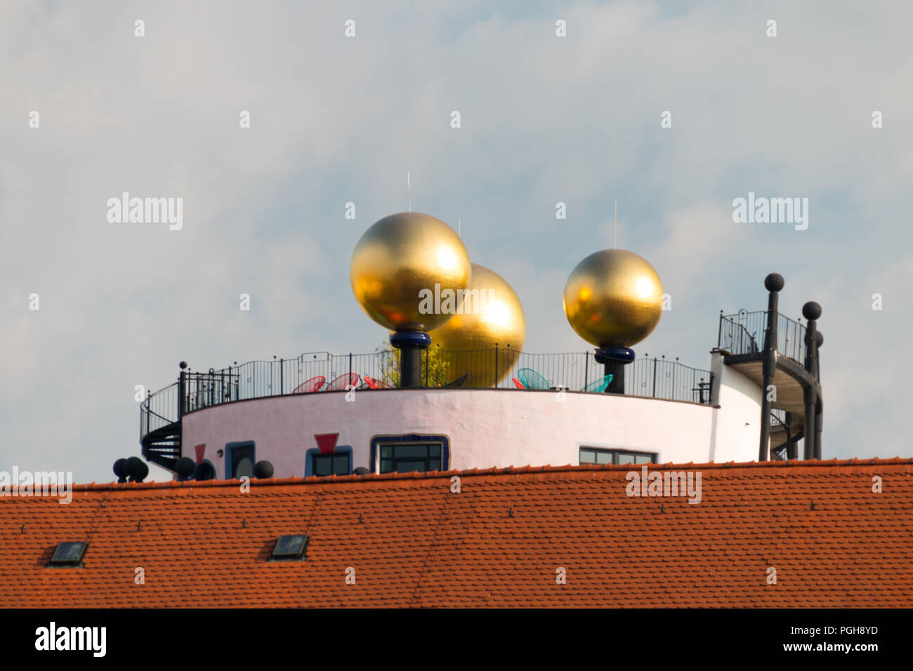Magdeburg, Germany - August 17, 2018: View of the golden balls of the Hunderwasserhause Grüne Zitadelle in Magdeburg, Germany. Stock Photo