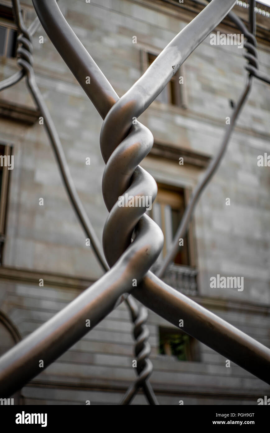 Strength in simplicity: a metal knot - Stock Image