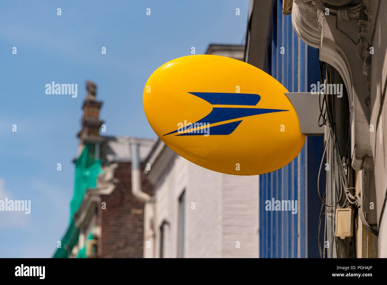Lille, France - 15 June 2018: Logo of La Poste, French national postal service on Rue Nationale. - Stock Image