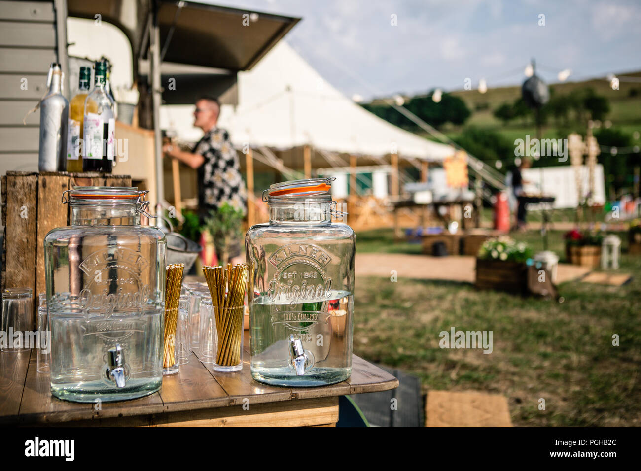 2 large kilner glass water dispensers at festival - Stock Image