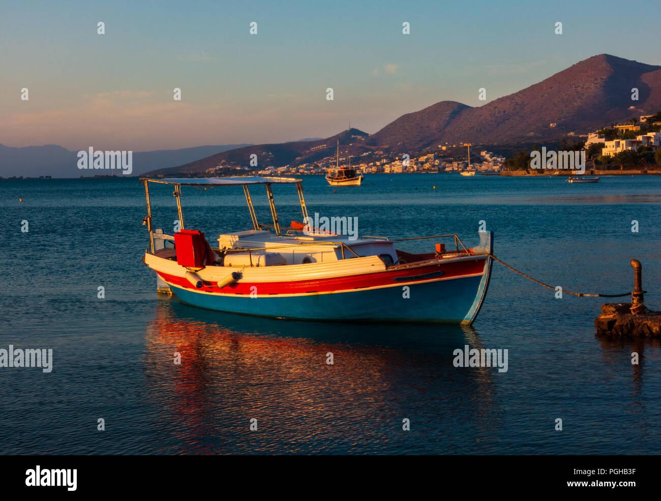 Fishing boat at down, Gulf of Mirabello, Crete Stock Photo