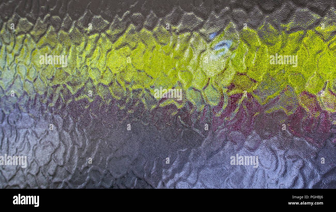Background of opaque glass with a green horizontal strip. Close-up of bumpy grainy texture. Frosted window pane, rough wavy relief pattern, dim glow. - Stock Image