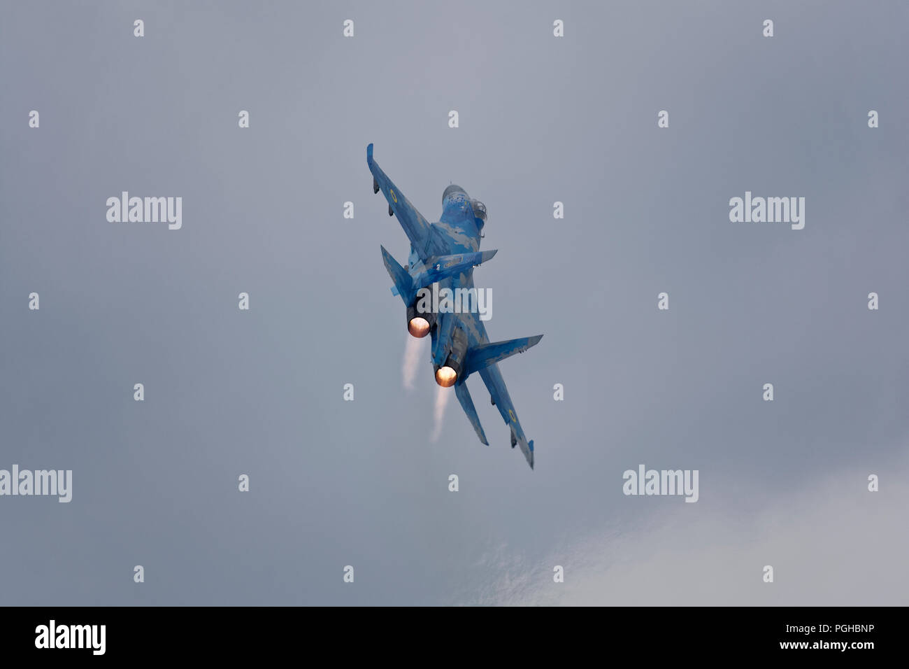 An impressive display of aviation power and manoeuvrability from the Ukrainian Air Force Sukhoi SU-27 air superiority jet fighter at the RIAT - Stock Image