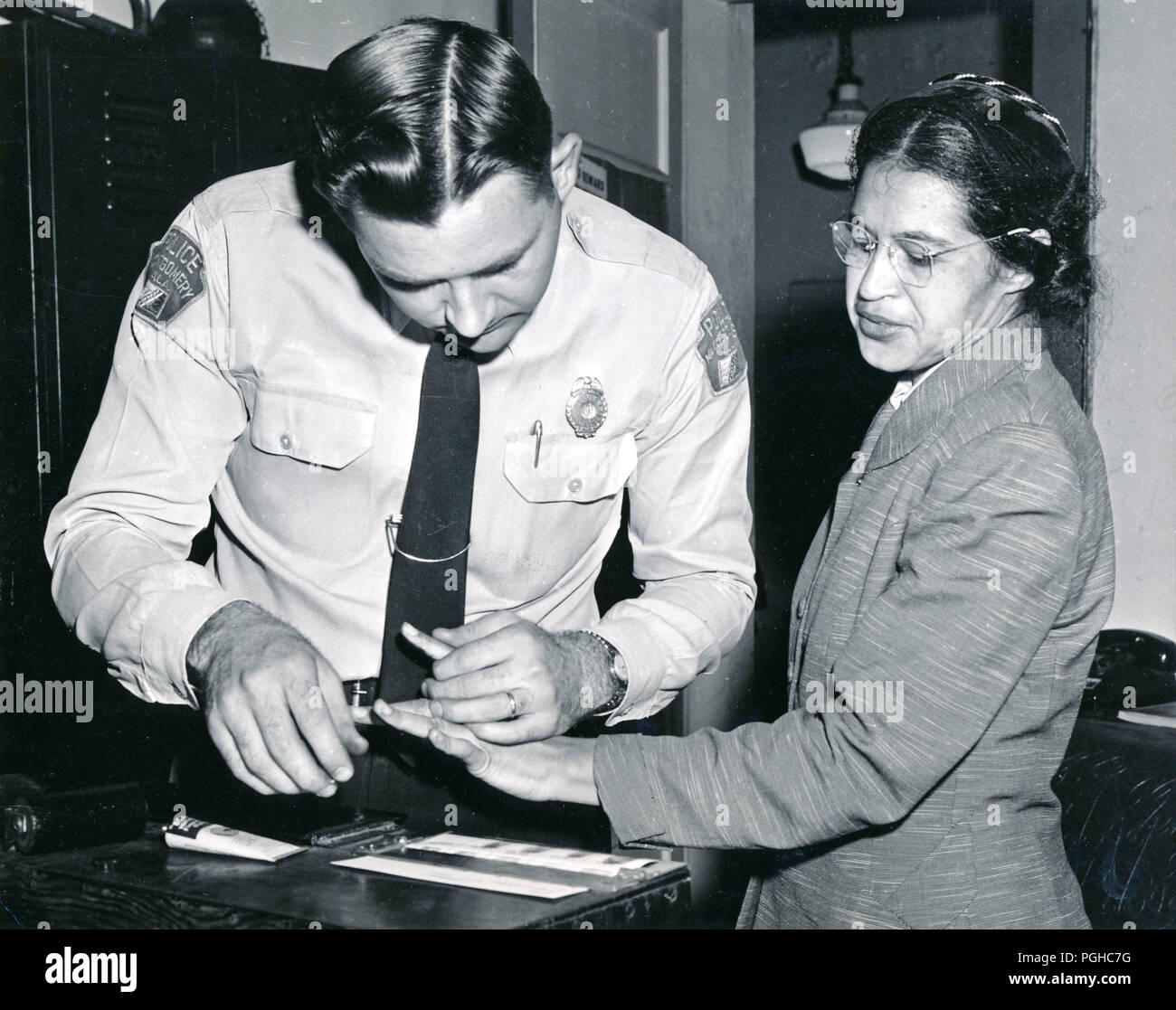 Rosa Parks being fingerprinted by Deputy Sheriff D.H. Lackey - Stock Image