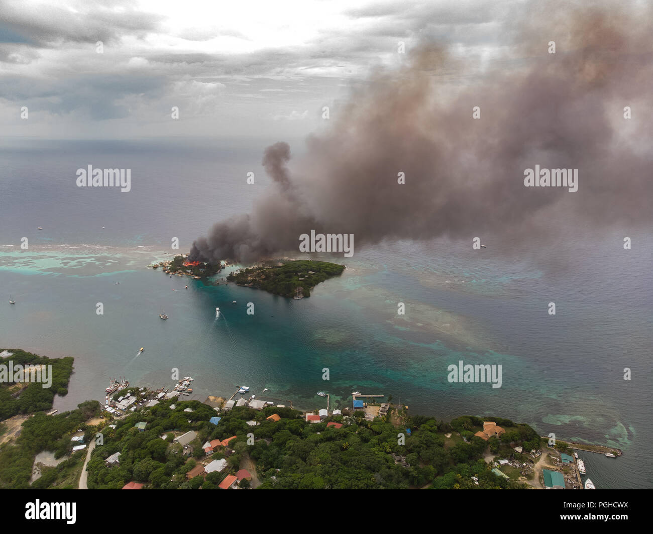 Disaster Fire On Small Caribbean Island - Stock Image