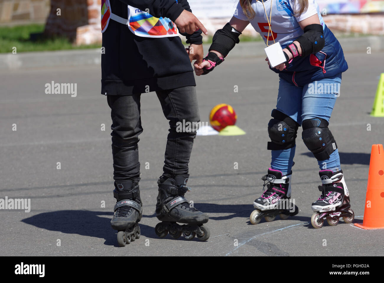 St. Petersburg, Russia - May 30, 2018: Disabled child with supporting instructor participates in the competitions Starts Of Dreams.Rollers. 32 disable - Stock Image
