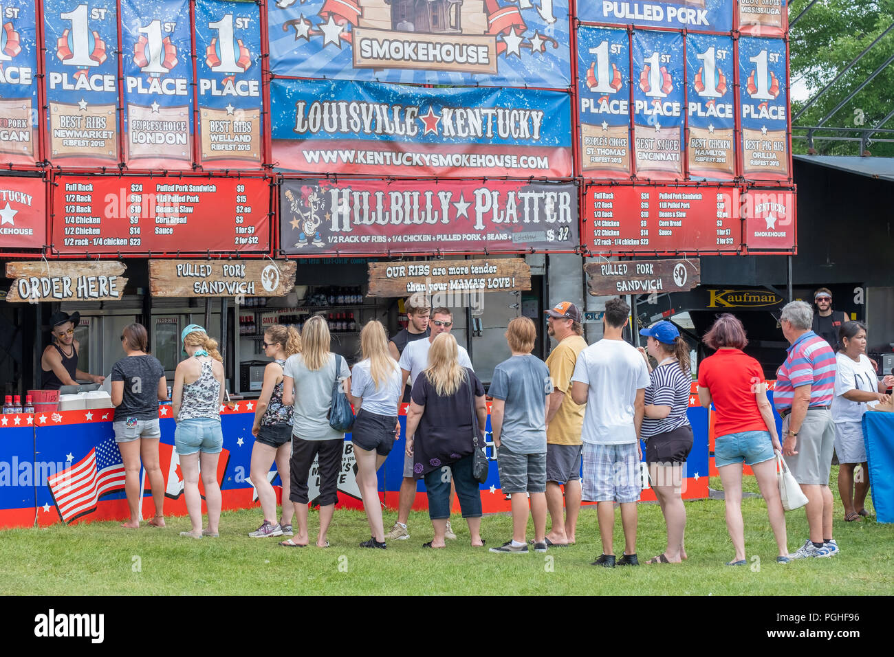 Fans of southern BBQ line up at the favourite pit to enjoy the food at the annual Ribfest in Orillia Ontario Canada. Stock Photo