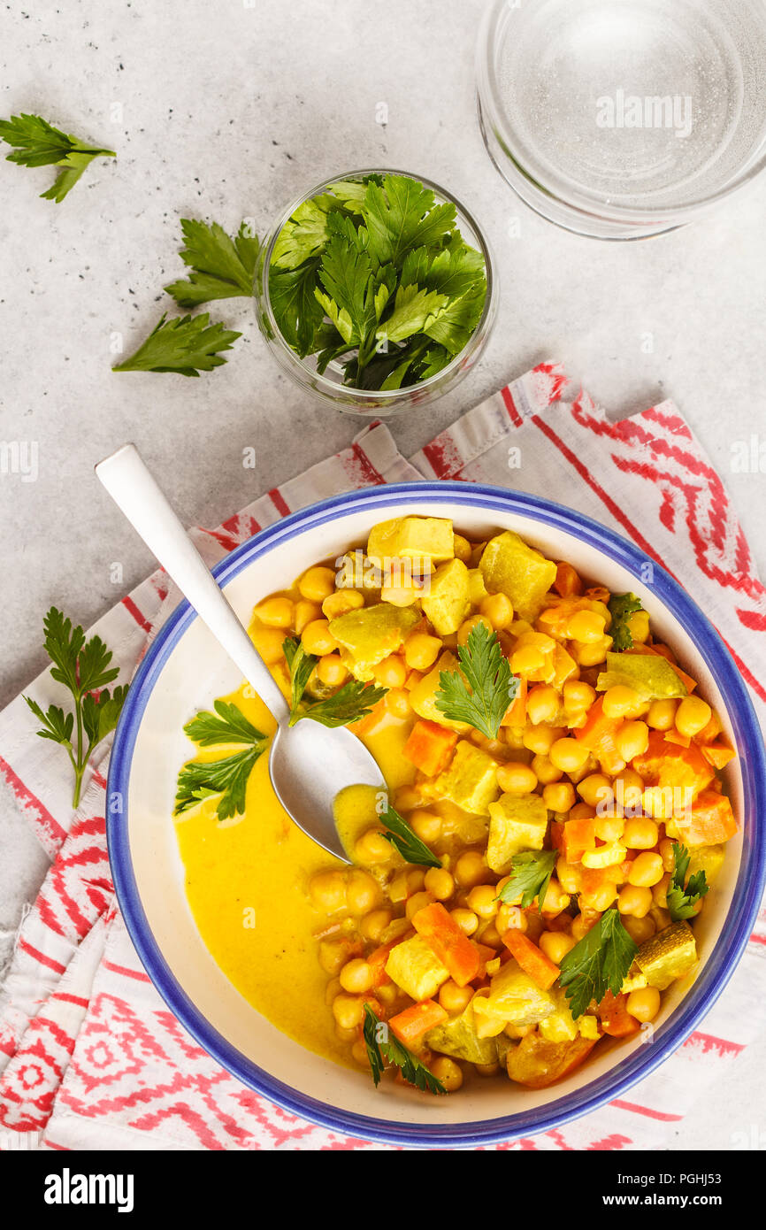 Vegan chickpea curry vegetables with coconut milk and coriander. Clean eating concept. - Stock Image