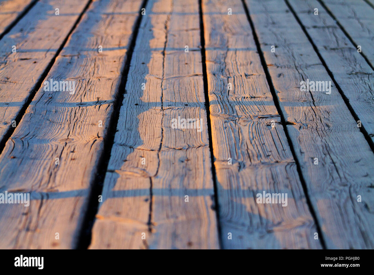 nice textured boards in perspective at sunset - Stock Image