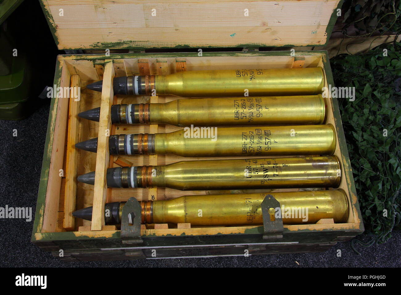 A whole crate of 57 mm Tank gun Armour Piercing Ballistic Capped Tracer rounds for sale having been emptied of expolosive substances at a show. - Stock Image