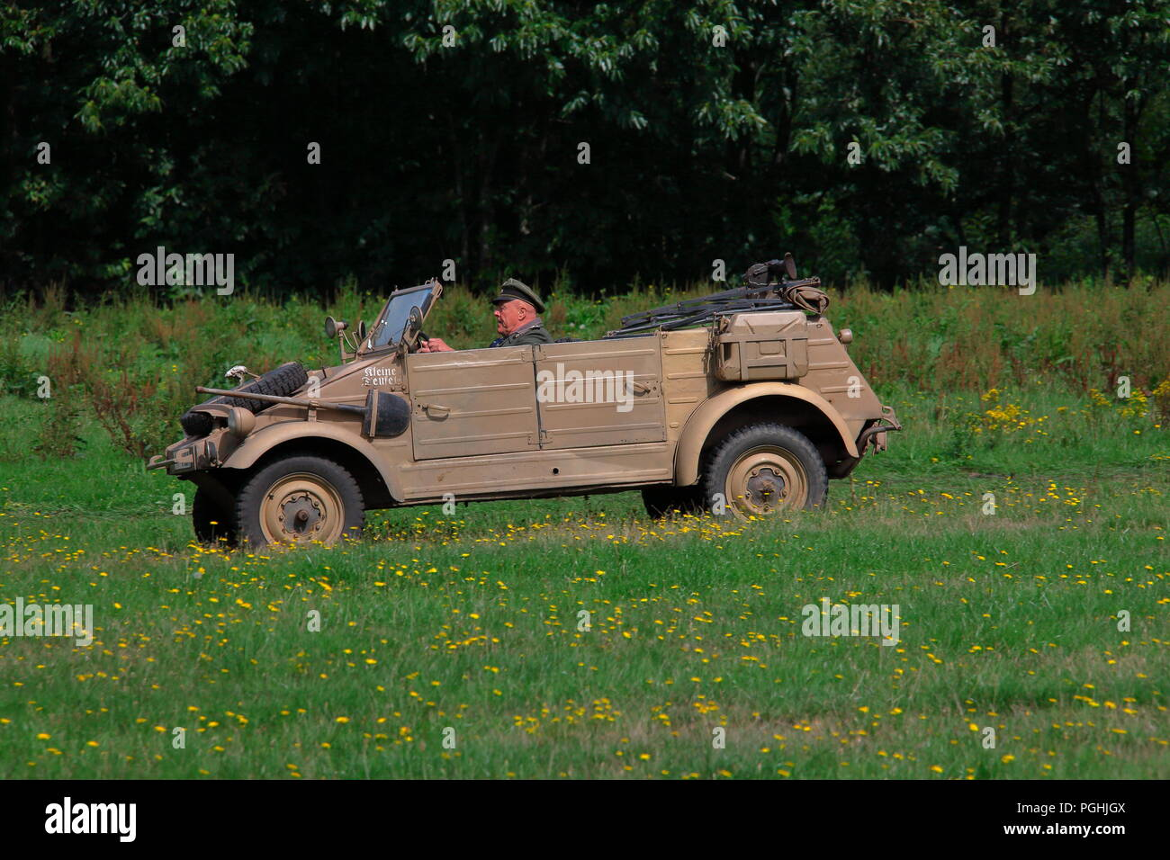 A lone senior military man enters the arena to conduct the battle from his vehicle during Detling militaria show 2018. - Stock Image