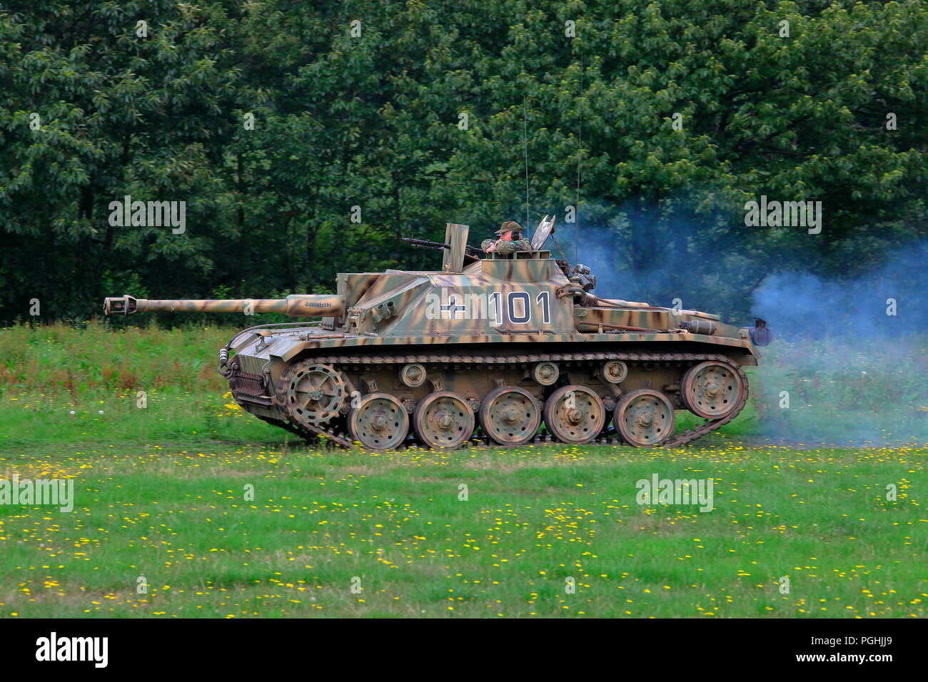 A wartime German tank doing manoeuvers in the display area of Detling showground during a battle re enactment. - Stock Image