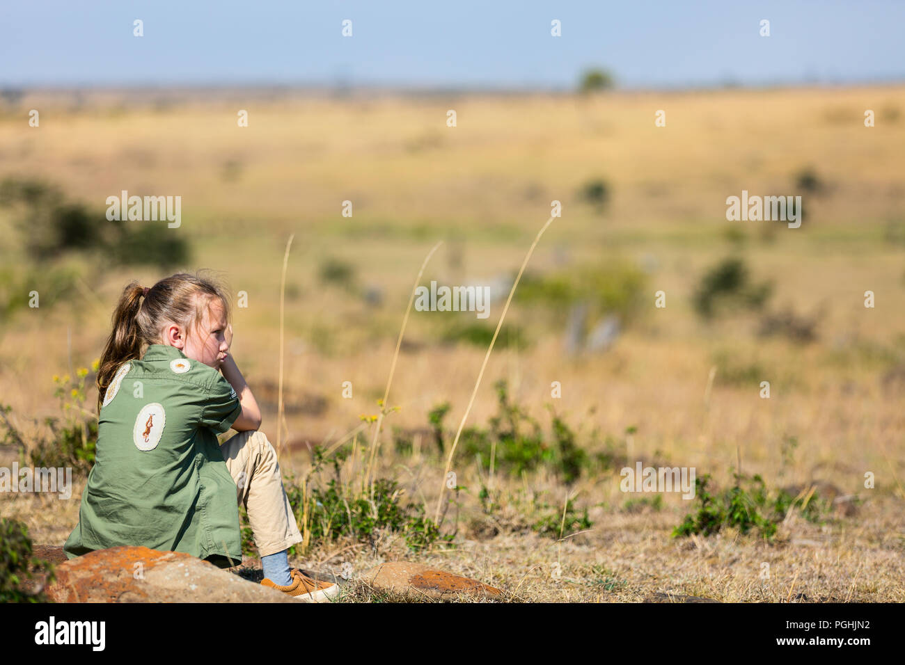 Little girl on safari vacation enjoying bush view - Stock Image