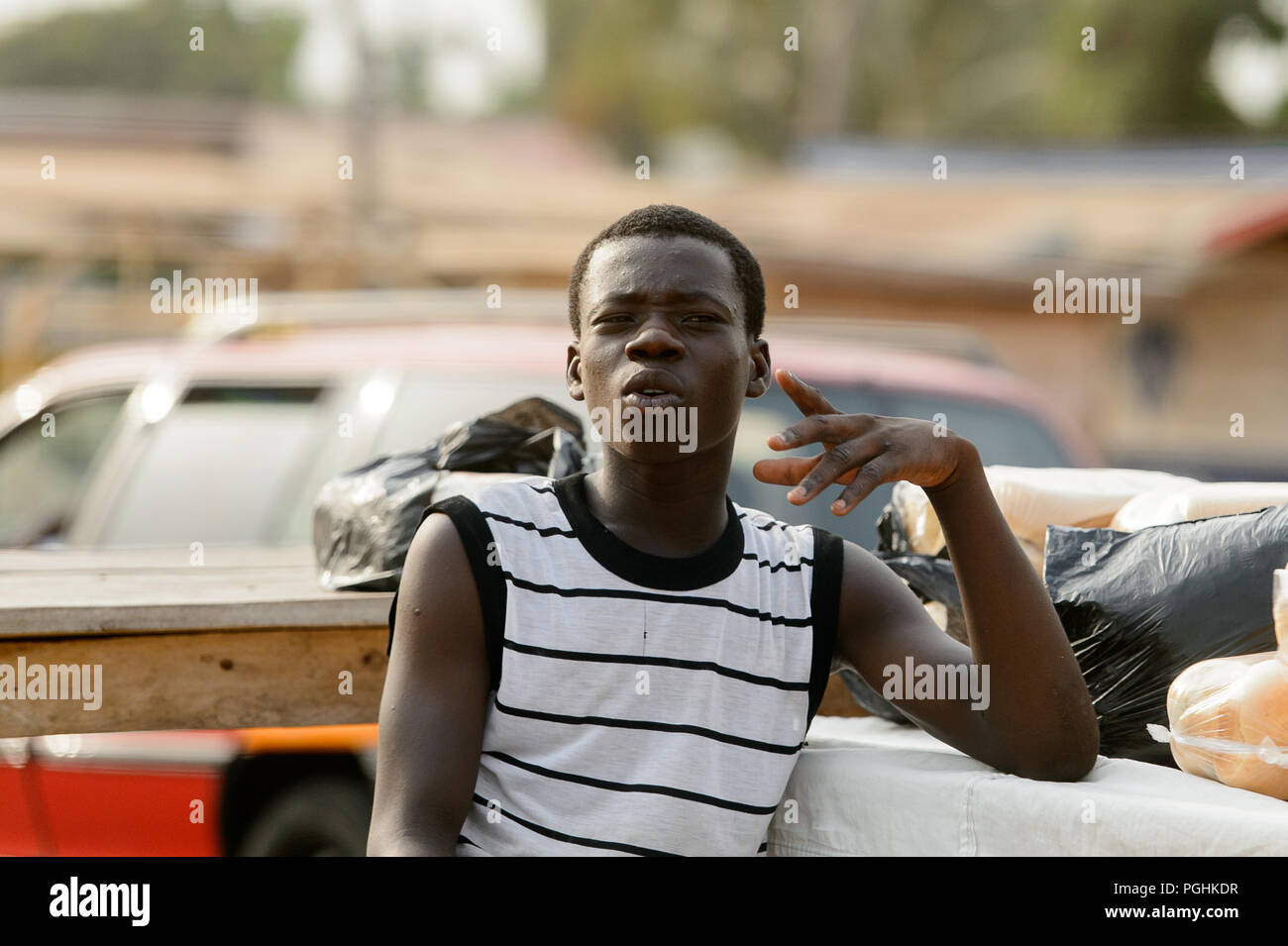 ACCRA, GHANA - Jan 8, 2017: Unidentified Ghanaian man tries to say something on the street. People of Ghana suffer of poverty due to the economic situ - Stock Image