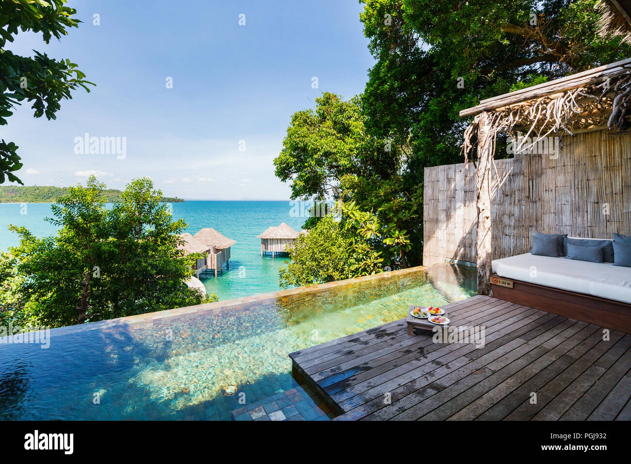 Stylish bungalow with private swimming pool in luxury resort. - Stock Image
