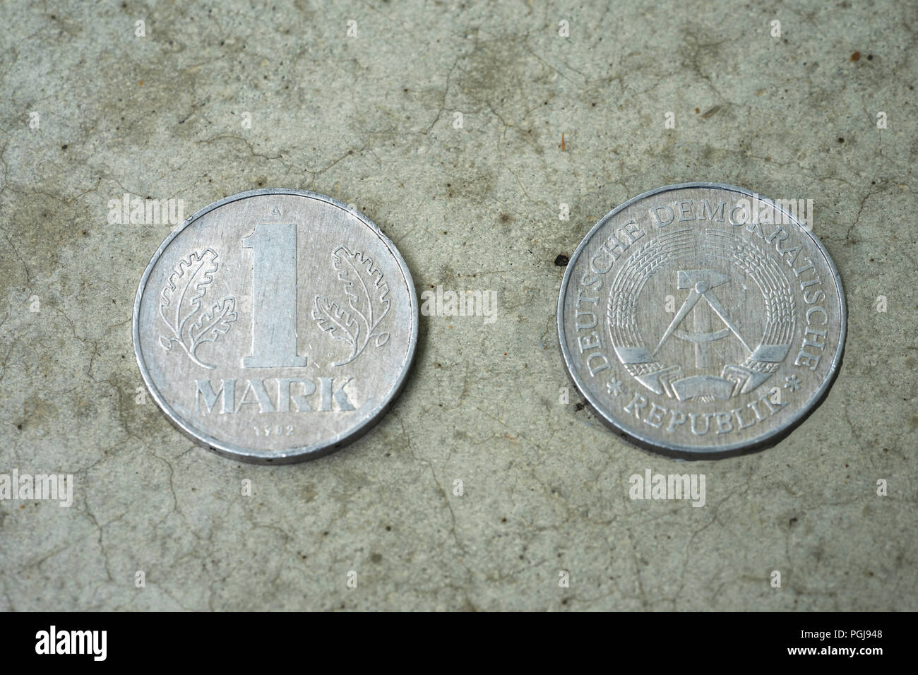 Front and back of a disused East German GDR one Mark coin - Stock Image