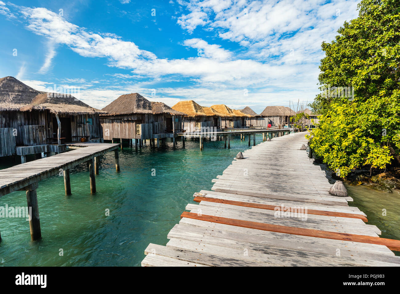 Resort bungalows over tropical water in Cambodia - Stock Image